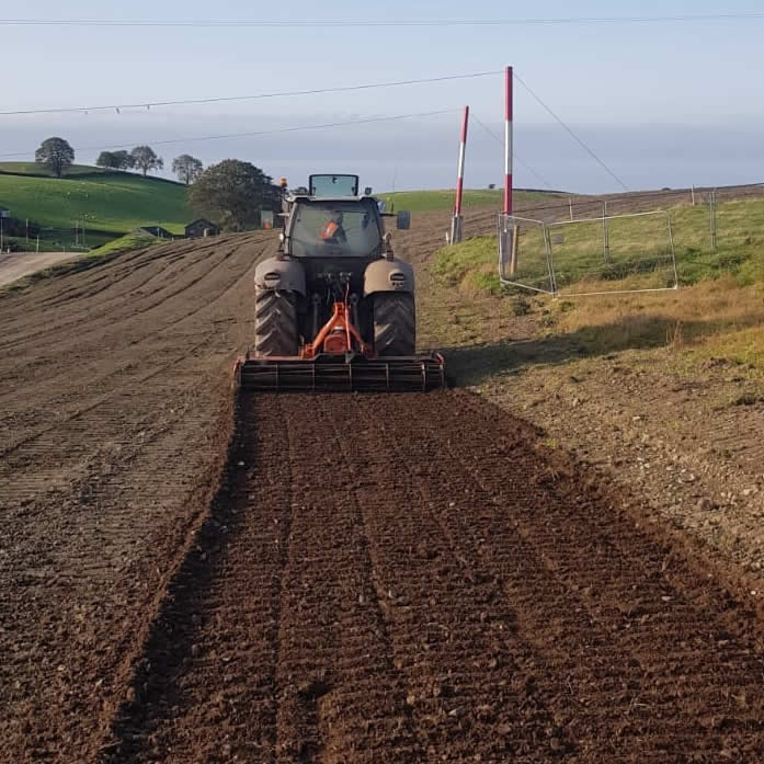 tractor and field ploughing