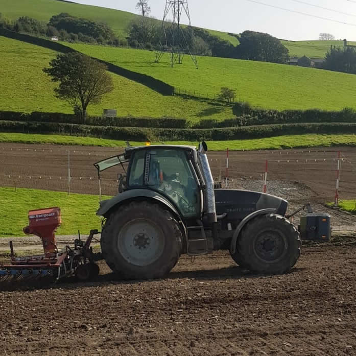 tractor reseeding a field